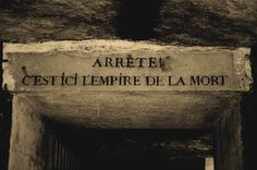 "Sign at the Catacombs in Paris. ""Stop! This is the empire of the dead."""