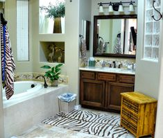 Pro Tip: When photographing a bathroom for a real estate listing, stay out of the mirror and skip the the toilet. We're not wild about the decor, but this is a great shot!
