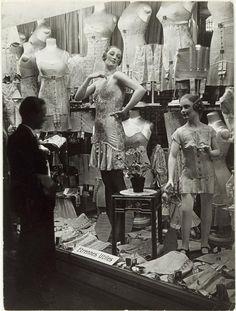 Window shopping in Paris, France during the 1920s. #vintage #1920s #fashion