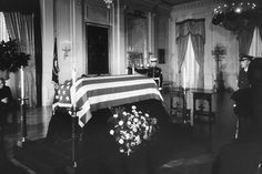 Nov 1963 ~ John F Kennedy's Flag Draped Coffin Lies In The East Room Of The White House - 98 Years Earlier Abraham Lincoln Lied In The Same Room Following His Assassination