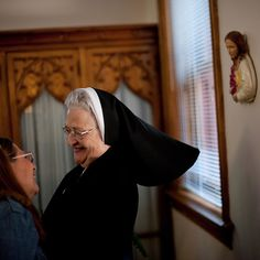 """Sister Mary Ann Hornick 82 greeted visitors to the Sisters of St. Francis of the Neumann Communities in Millvale a suburb of #Pittsburgh. Before Sister Mary Ann retired in 2002 she worked as a teacher and hospital administrator. """"Pope Francis has a compassionate energy and he gives people hope in dealing with what is going on in the world"""" she told @jeffswensen. During #PopeFrancis visit to the United States we are sharing photos by @jeffswensen who searched for signs of #Catholicism in the…"""