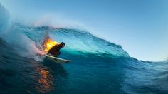 An idiot surfs whilst lit on fire, at Teahupoo, Tahiti July 2015, but that wave is beautiful.