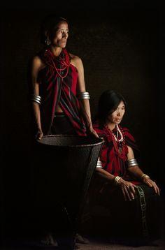 Two Yimchunger women with a Khang (cane basket) , Kuttur village, Tuensang Dist. Nagaland
