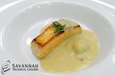 Seared Salmon with Lemon Cheese and Herb stuffed Ravioli plated with Lobster Veloute and topped with Basil Chiffonade. — at Savannah Technical College. For more student chef creations like Chef Jean Vendeville at www.facebook.com/ChefJeanVendeville.