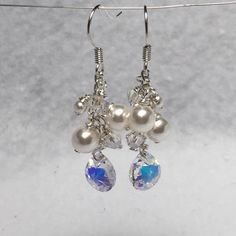 A personal favorite from my Etsy shop https://www.etsy.com/listing/225699653/bridal-swarovski-crystal-and-pearls-drop