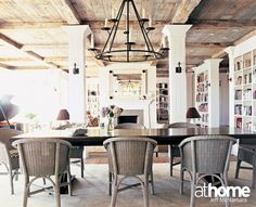 Reclaimed, antique barn wood ceiling and floors brings a warm cozy feeling to this water front home.