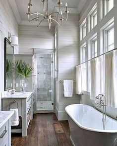Have any of you gone against all advice and used wood floors in your bathroom? I love the rich, warm look more than anything. I desperately want to use these in our master bathroom, but I'm scared! Does anyone have experience with this? #masterbath #coastalfarmhouse #farmhouse #woodfloors #coastalliving #southernliving