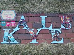 Hand Drawn And Hand Painted Wood letters KAYLEB in DISNEY CARS theme woth Mack, Lighting McQueen, Tow Matter, the king, Ramone,  and Guido Www.facebook.com/andbabymakesthreee