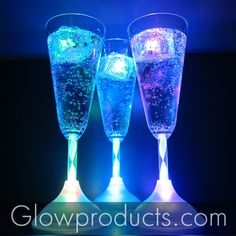 Glowing Champagne Glasses with LED Ice Cubes! - https://glowproducts.com/us/barglowproducts