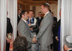 A same-sex couple say their vows during a Jewish ceremony. Photo courtesy Jacqui DePas Photography