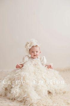 Our Victorian Feather Christening Headpiece. It can be made any size, and color. We can make it white or ivory, if you have any questions please