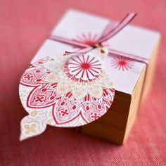 This handmade ornament idea is the perfect gift tag! Find more festive red and white gift wrapping ideas here: http://www.bhg.com/christmas/gift-wrapping/gift-wrapping-ideas/?socsrc=bhgpin122214stampedornamenttag&page=13