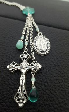 Check out this item in my Etsy shop https://www.etsy.com/listing/387047268/aqua-pendant-necklace-with-crucifix-and