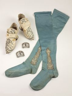 Shoes were made with delicate decoration of embroidery and lavish trimmings. The decorative buckles that adorned shoes could be transferred from one pair to another. Another important part of dress was stockings. Knit stockings would shift causing them to move requiring them to be held with garters. The garter was usually a piece of ribbon or a leather buckling strap made from leather or decorated cloth.