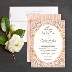 Rustic with a romantic touch! Our new folk floral wedding invitation by Hooray Creative features your details framed by lovely florals and a woodgrain background.