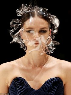 Environmentally unfriendly: A selection of models charged down the runway in masks and headpieces that looked remarkably like of blowing against their faces Weird Fashion, High Fashion, Vanessa Moe, 3d Mode, Body Adornment, Recycled Fashion, Fashion Mask, Headgear, Wearable Art