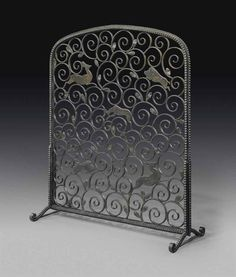 EDGAR BRANDT (1880-1960) 'LA FÔRET' A FIRESCREEN, CIRCA 1925 patinated wrought-iron 37¾ in. (96 cm.) high, 31 in. (78.7 cm.) wide, 12¼ in. (31.1 cm.) deep stamped twice E. Brandt and Made in France