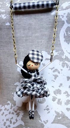Doll made with wooden bead head, yarn, pipe cleaners & floss