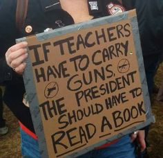 TrumPutin in the White House: |sign: If teachers have to carry guns the president should have to read a book #MarchForOurLives