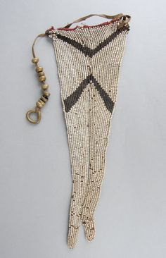 Apron made of glass beads, with leather backing, of 'swallowtail' form.