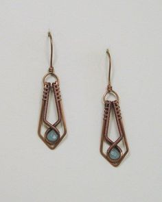 Sweet Amazonite briolettes accent these woven copper wire dangle earrings. The copper wire frame has been hand formed, hammered, sanded and polished specifically for the lovely Amazonite briolette bea