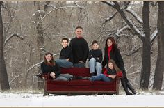 Have family sit, lean, and stand beside the couch in the middle of a winter scene. So pretty! The red definitely pops.
