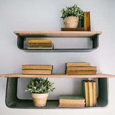 Creating dimension is one of Joanna's essential checklist items when designing a space. You can create dimension with a wreath, an antique window, an interesting architectural piece, unique shelving units and much more. | Our Wall Shelves are back in stock - shop link in profile. |