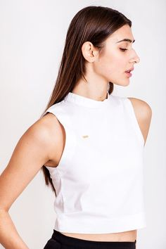 White top by Dott. Does your closet own enough essentials for the perfect monochrome foundation? Our answer to this question, is that we can never get enough of the basics, but we are really not that interested in the plain basics. No, show us some edgy basics instead. This cotton top can easily be added to your wardrobe of cool basics and you can combine it with some raw jeans for a hot look and then style it up with some statement jewellery.     €70.00 REPIN TO YOUR OWN INSPIRATION BOARD Raw Jeans, Cotton Style, Piece Of Clothing, Slow Fashion, Statement Jewelry, White Tops, Monochrome, Foundation, Essentials