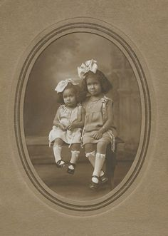 :::::::::: VIntage Photograph ::::::::::  Two African American sisters with large bows in their hair and sweet expressions.