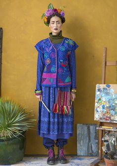Frida vest:  Fabulous lush vest full of glorious embroidered flowers, leaves and birds mixed with austere geometric shapes and hidden buttons. Here the joy of patterns has reached full bloom!