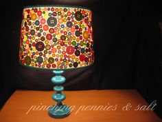 button lampshade - repurpose lamp from former room and paint the lamp base.  Add a new shade, with buttons for a vintage feel.