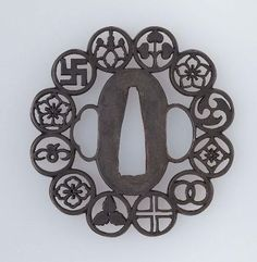 Tsuba with design of twelve mon (crests)  Japanese, Edo Period, early to mid-19th century