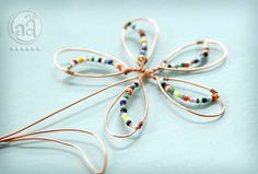 Wire Flower with Beads - Ornament - Playful and Delicate. $7.50, via Etsy.