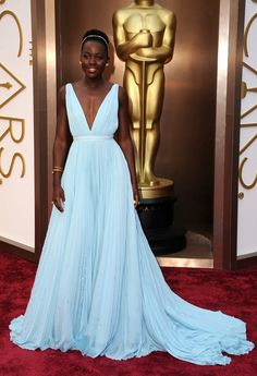 Lupita Nyong'o in sky blue plunging v-neck pleated custom Prada gown. Best Dressed at the 86th Academy Awards 2014 the Oscars. #Oscar2014 #Oscars2014 #AcademyAwards2014