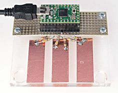 CapacitiveSensor, written by Paul Badger, lets you create sensors that can detect touch or proximity.