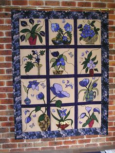 Stained Glass flowers - completed in 2002 at Creative Sewing Centre, Coffs Harbour. The quilt uses black wool and zig-zag stitch to give stained glass effect.