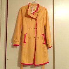 Winter Jacket Yellow pea coat jacket with pink trimming. The jacket was purchased in a boutique. Jackets & Coats Pea Coats