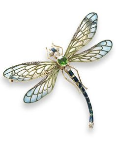 An enamel, demantoid garnet and diamond dragonfly brooch, circa 1900. The thorax set with a cushion-shaped demantoid garnet and two old brilliant-cut diamonds, the eyes with single-cut diamonds, the abdomen decorated with blue enamel and a single old brilliant-cut diamond, between pale green plique-à-jour enamel wings with blue tips and rose-cut diamond highlights, detachable brooch fitting, fitted case by Hall & Co, King St, Manchester, Hatton Garden, London.