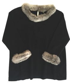 SIMPLE ELEGANCE This year ask Santa for something that will truly be a timeless staple in your closet. This cashmere sweater with rabbit trim will surely be that piece. Versatile for dress casual or party fabulous. Evelyne Talman, 3301 Frederica Rd., 912.638.3470. evelynetalman.com.