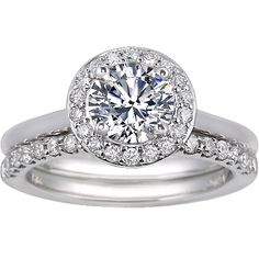 This stunning matched set features an engagement ring with an intricate halo of pavé-set diamonds which embraces the center gem. This halo is elevated to allow for maximum light play and it accommodates the matching petite shared-prong diamond wedding ring to tuck underneath and sit perfectly flush. The number of diamonds in the halo and the carat weight varies depending on size of center gem, and the set is available in platinum, white gold, and yellow gold from @Brilliant Earth.