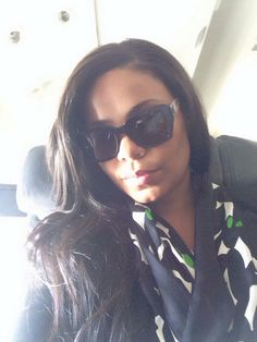 Me. Sunglasses. Scarf. Airplane. Taking off! Happy Friday! Muah.