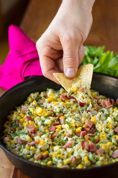 Corn Dip -- this hot creamy and cheesy corn dip needs to go on your MUST TRY ASAP list right now! Frozen sweet corn, jalapeno peppers, bacon and cilantro + cream cheese and mozzarella cheese combine to create the ultimate party dip… | unsophisticook.com