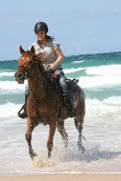 Horse-riding on the beach at Noosa, Australia