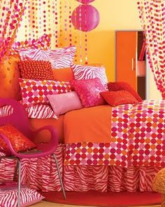 Orange, pink and yellow bedroom- so cute and vibrant!