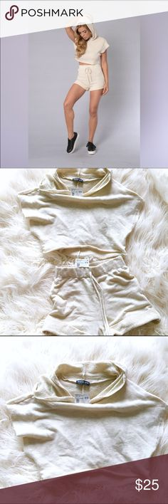 Fashion Nova Pretty Hurts beige sweater Set XS $38 Instagram In trend! Fashion Nova Pretty Hurts Hooded Cotton Crop Top & Shorts Set  Condition: New with tags Color: Beige Size:XS Retail Price US$17.99 for each Selling them as a set only.  Listed under urban outfitters just for more exposure (: Urban Outfitters Tops Crop Tops