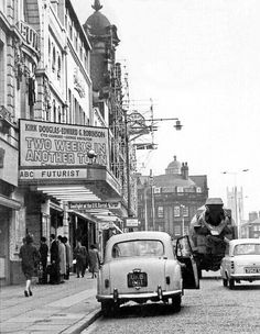 """Kirk Douglas and Edward G. Robinson share the marquee at a movie house in Liverpool's Town Centre, probably in late 1962 or early 1963.  The movie – """"Two Weeks In Another Town"""" – had its European release in Dec. 1962."""
