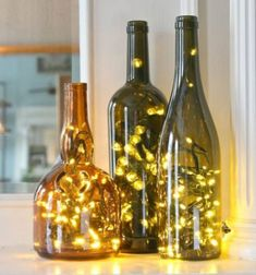 An LED light string (Christmas light) can transform that fancy bottle of wine from a special occasion into a lasting (and useful! Use these bottle lights to brighten up any dark corner, as a(Bottle Lights Christmas) Christmas Wine Bottles, Lighted Wine Bottles, Glass Bottles, Diy Design, Design Ideas, Jar Lights, Bottle Lights, Glass Lights, Glow Stick Jars