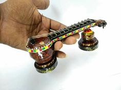 These miniature veena is made with waste Xerox papers. Paper Quilling, Quilling Ideas, Indian Dolls, Newspaper Crafts, Zentangle Patterns, Creative Crafts, Handmade Crafts, Ceramic Art, Paper Art