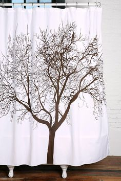Delicate tree design shower curtain. Check out bathroom decor ideas @BrightNest Blog.