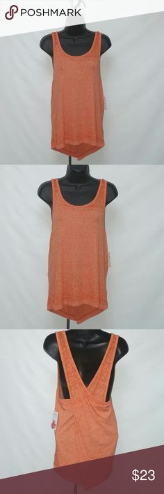 FREE PEOPLE TANK TOP Brand new with tag. Criss cross back. NR05200373 Free People Tops Tank Tops